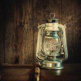 Oil Lamp on a Wooden Background Royalty Free Stock Photography