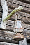Oil lamp on wooden hut background Stock Photo