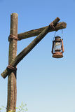 Oil lamp on wooden post Stock Photo