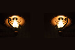 Oil lamps. Two kerosene oil lamps in the dark stock photo