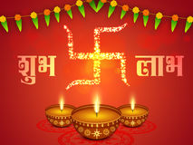 Oil Lamps (Diya) for Happy Diwali celebration. Creative illuminated Oil Lamps (Diya) with Glowing Golden Swastika symbol and Hindi Text Shubh Labh (Goodness and