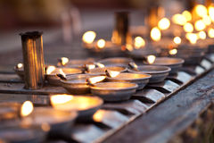 Oil lamps line the prayer wall surrounding central Royalty Free Stock Photography