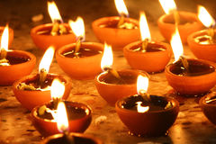 Oil lamps lit in row, diwali festival Royalty Free Stock Image