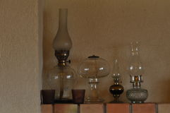 Oil lamps. Ornament on the mantelpiece. Light source. Stock Image