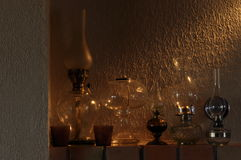 Oil lamps. Ornament on the mantelpiece. Light source. Stock Photos