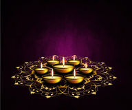 Oil lamps with place for diwali greetings over dark background Stock Image