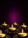 Oil lamps with place for diwali greetings over dark background Royalty Free Stock Image