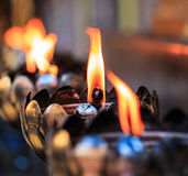 Oil lamps of the prayers at the temple Stock Images