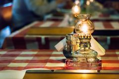 Oil lamps on a table of a greek tavern, selective focus. Oil lamps on a table inside a greek traditional tavern - restaurant in Larissa, Greece Stock Photography