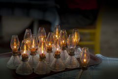 Oil lamps used for lighting. A couple of oil lamps on a tray over the table Stock Images