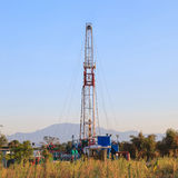 Oil Land Drilling Rig Working In The Field Stock Image