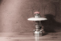 Oil lantern on old  steel background Royalty Free Stock Photo