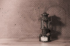 Oil lantern on old  steel background Royalty Free Stock Photography
