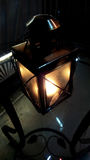 Oil lantern shining in the dark Stock Photos