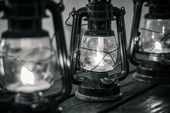 Oil Lanterns on wooden table in black and white stock image