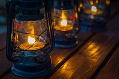 Oil Lanterns on wooden table royalty free stock image