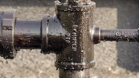Oil leak and dropping from pipeline stock footage
