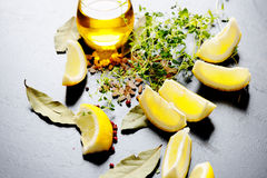 Oil and lemons Stock Images