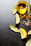Oil and lemons Stock Photography