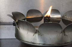 Oil light candle metal aluminium fire concept Royalty Free Stock Photos