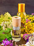 Oil and lotion with flowers on board Stock Photo