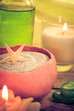 Oil massage aromatic candles stones Zen Stock Photo