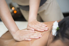 Oil massage on back by therapists Royalty Free Stock Images