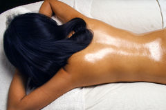 Oil Massage at Spa. Detail of a young woman waiting to enjoying an oil massage royalty free stock images