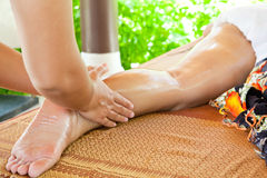 Oil Massage Spa. At leg by Hand in tropical garden for wellness and healthy background stock image