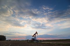 oil mine at sunrise royalty free stock images