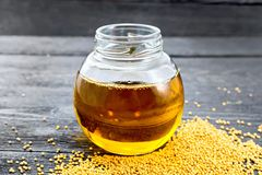Oil mustard in jar on board Royalty Free Stock Images