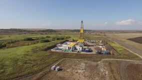 Oil and natural gas production, aerial view of well in field in summer day