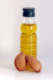 Oil olive. Bottle oil olive and almonds Stock Images