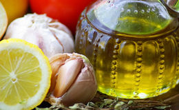Oil Olive and condiments. Oil Olive with vegetables and condiments royalty free stock photo