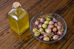 Oil and olives over wood table. Royalty Free Stock Photos