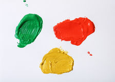 Oil paint. Green red and yellow oil paint on white background Royalty Free Stock Photo
