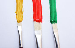 Oil paint brushes. And paint on white background stock images