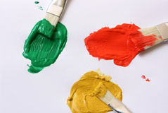 Oil paint and brushes closeup. On white paper background Stock Photography
