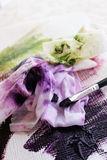 Oil paint on canvas. Green and purple oil paint on canvas stock images