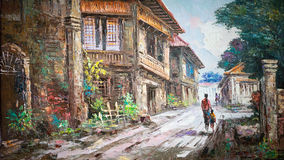 Oil painting on canvas. An oil painting on canvas showing a rural street town in the Philippines. The image shows wooden houses of Spanish design and a mother stock illustration