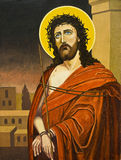 Oil painting of Christ. An oil painting of Jesus Christ standing while wearing a robe and crown of thorns Stock Images