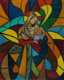 Painted glass mosaic window with woman and child stock illustration