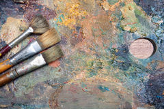 Oil painting scrubbing brush Stock Images