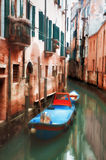 Oil painting style picture of small canal in Venice Stock Photo