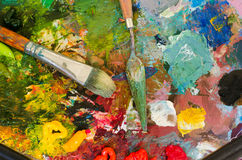 Oil paints and brush on palette. Abstract Background.  Royalty Free Stock Photo