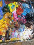 Oil paints and color boards. A close-up of oil paints and color plates. A variety of colors stock images