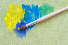 Oil paints and paint brush Stock Photos