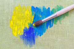 Oil paints and paint brush Stock Images