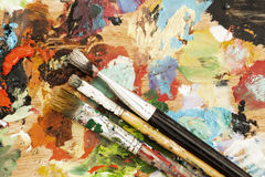 Oil paints and paint brushes Stock Images
