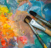 Oil paints and paint brushes Stock Photography